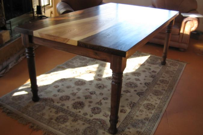 Dining table in ash and black walnut